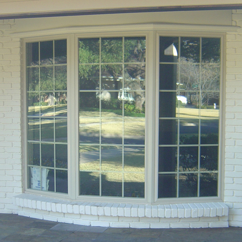 Cedar Trimmed Marvin Wood Windows at the Tropphy Club Texas overlooking the 9th green