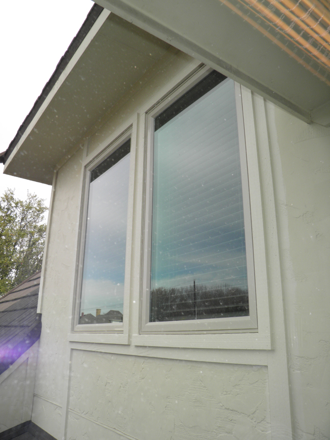 Vinyl windows can be made as casement windows which swing out and have the screen on the inside.